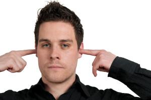 Closeup of young man not listening