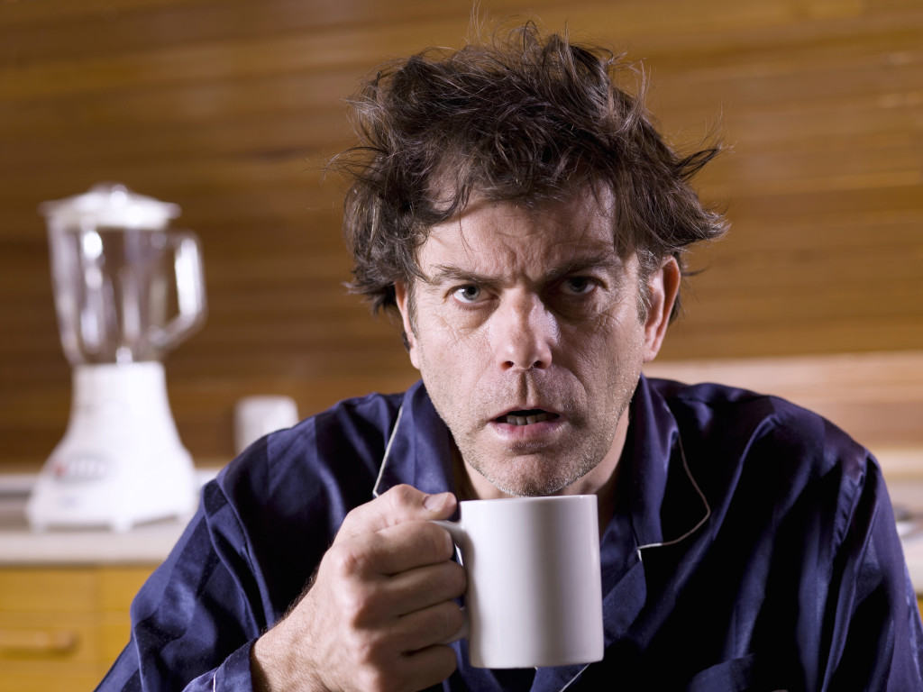 Mature man, newly built, with a cup of coffee